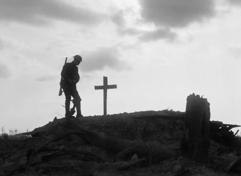 Ernest Brooks, 'IWM Q 2756', A British soldier stands beside the grave of a comrade near Pilkem during the Third Battle of Ypres, part of Ministry of Information First World War Official Collection, (22/08/1917)